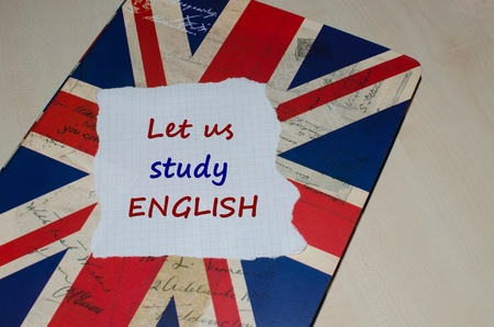 Let us study English message on paper note  English learning concept Reklamní fotografie