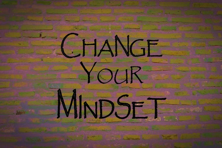 open minded: Motivational message Change your mindset over brick wall background