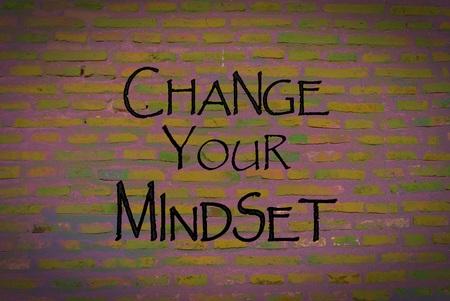 open minded: Motivational message Change your mindset over brick wall background