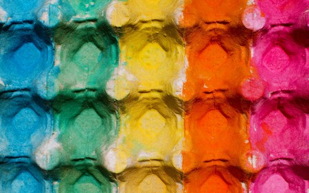 vibrant paintbrush: Colorful egg cardboard carton painted as a background
