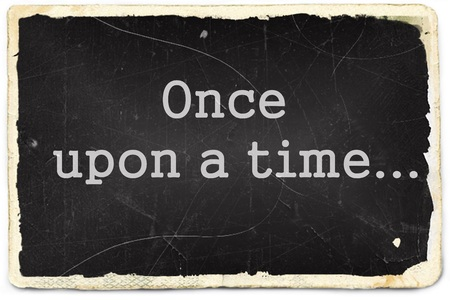 Once upon a time written on old photo paper background photo
