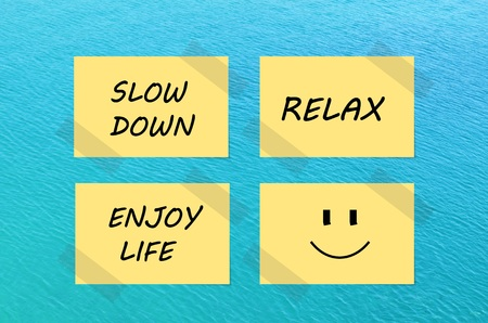 Tips for relaxation on yellow notes over blue sea background Reklamní fotografie