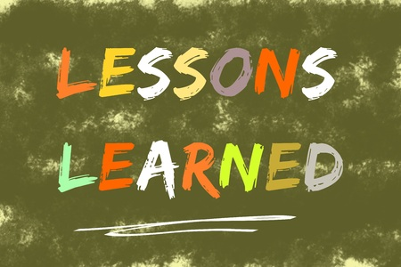 learned: Lessons learned text written over dark green background Stock Photo