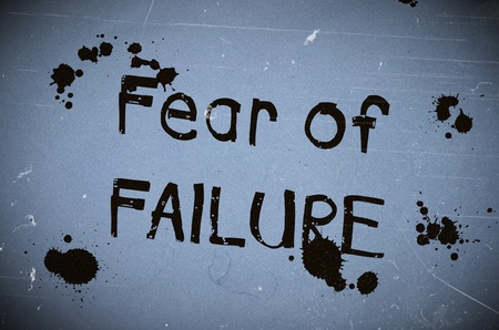 fear of failure: Fear of failure text written over blue old paper