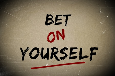 bet: Bet on yourself written over old piece of paper