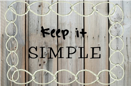 straightforward: Keep it simple message written over wooden background