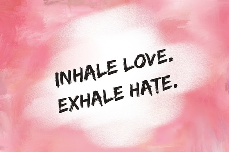 to inhale: Inhale love exhale hate message over pink painted background