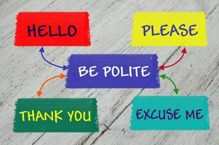 polite: Be polite message over grey wooden background