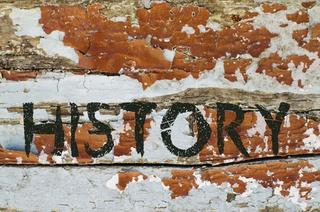 chronicle: History written on old piece of wood with cracked color paint