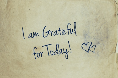 gratefulness: I am grateful for today written on old piece of paper Stock Photo