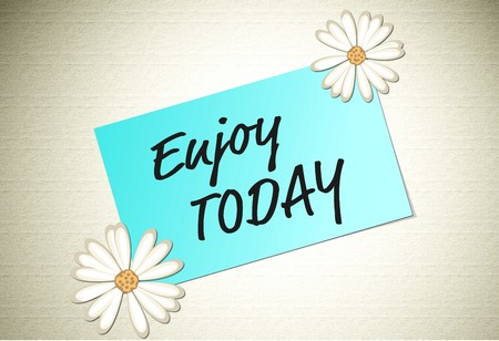 note paper: Enjoy today positive message on paper note with flowers on the corners Stock Photo
