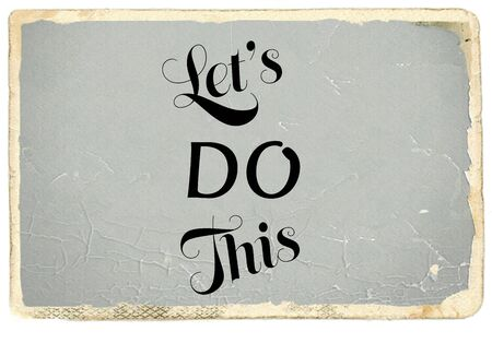 Lets do this motivational message on old photo paper background Zdjęcie Seryjne
