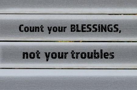 contentment: Count your blessings positive message on grey wooden background