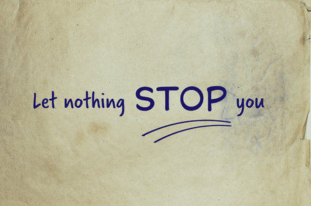unstoppable: Motivational message let nothing stop you on old piece of paper