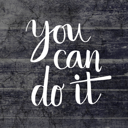 you can do it: You can do it hand lettering message on grunge wooden background