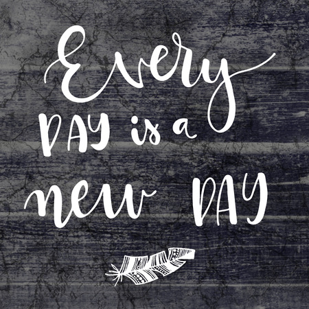 new day: Every day is a new day hand lettering motivational message on grey background