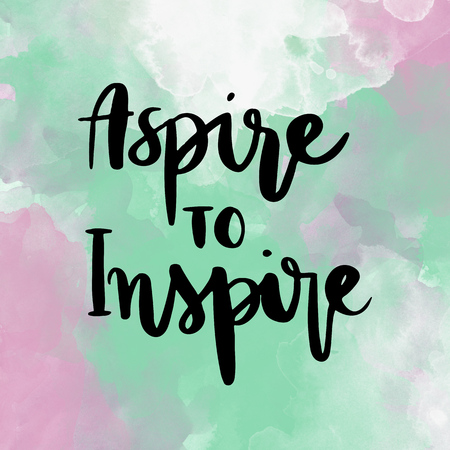 Aspire to inspire inspirational hand lettering message on colorful background Stock Photo