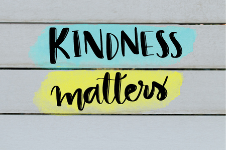 Kindness matters inspirational message on grey wooden background Фото со стока