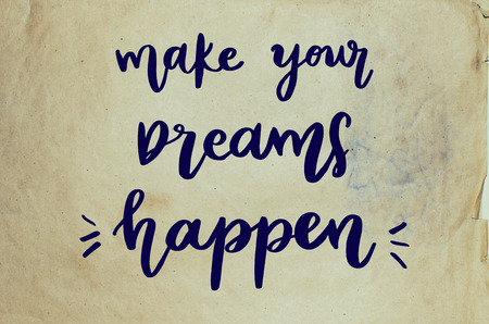 Make your dreams happen handwritten message on old paper