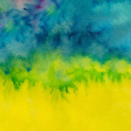 青・緑・黄色の色で背景を描いた水彩画