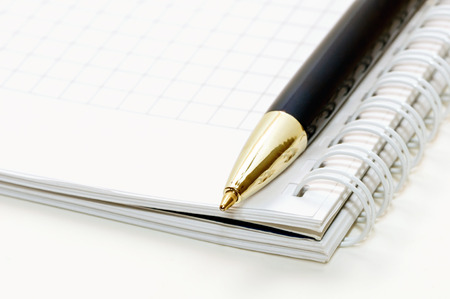 Notepad and pen on a white background photo