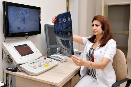 Baku on August 15 2011. Office of the roentgenologist. The doctor investigates xray Membranula.