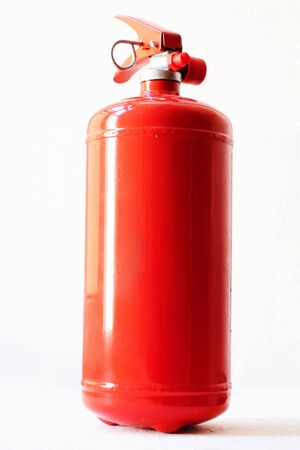 Red Fire extinguisher, Fire extinguisher available in fire emergencies.