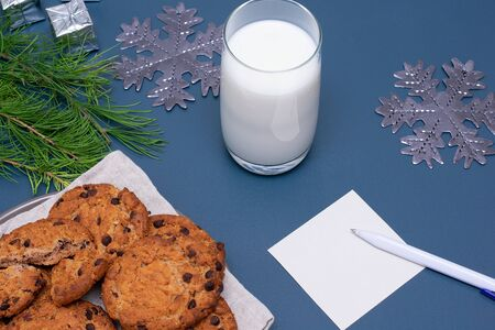 Milk, chocolate cookies and a note for Santa Claus