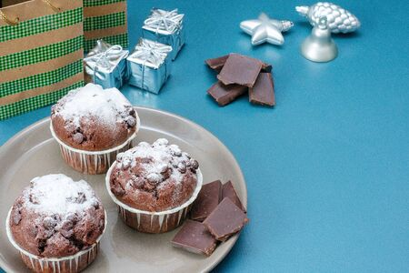 Festive dessert. Christmas chocolate cupcakes. Christmas sweets. New Year's dessert
