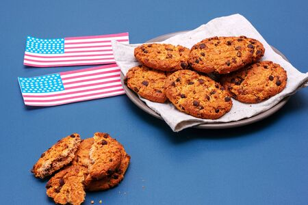 Chocolate breakfast cookies with a glass of milk on a turquoise table. Patriotic breakfast concept - happy presidents day. Archivio Fotografico
