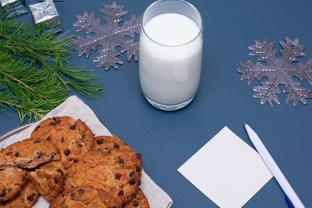 Milk, chocolate cookies and a note for Santa
