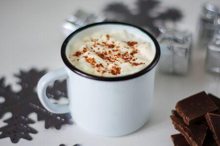 Milkshake in an iron mug and Christmas decorations on a wooden table 版權商用圖片
