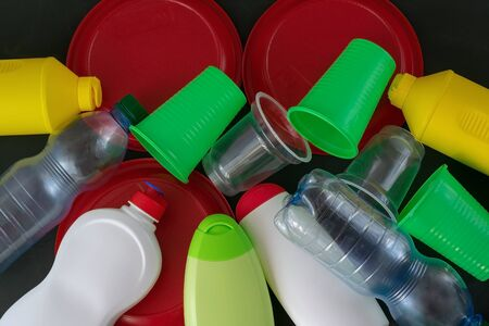 Plastic recycling. The concept of ecology, collection and disposal of plastic. Top view. Banque d'images - 135439461