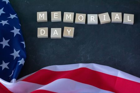 Memorial Day. American flag and the inscription on a black background