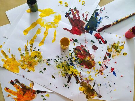 Children's hands are stained with paint for painting. The concept of creativity, childhood, leisure, drawing.