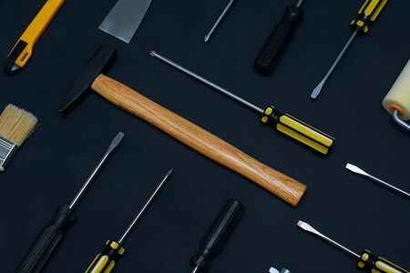 Flat lay with various hand construction tools on a black background. Labor day background concept. Foto de archivo