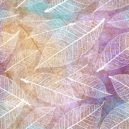 Autumnal skeleton leaves seamless pattern on a grunge artistic background. 版權商用圖片