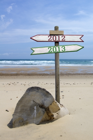 Double directional signs on a beach 2012 to 2013 Stock Photo
