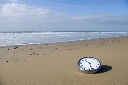 Clock on a beach Stock Photo