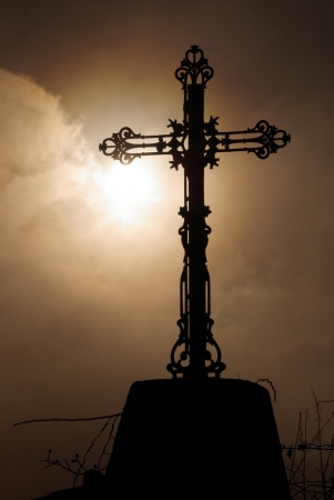 Antique cross against a dramatic sky