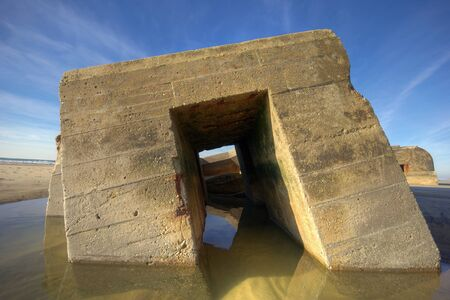 Old ruins of bunker. On some French beaches, old ruins of World War II are still visible
