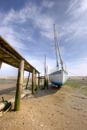 low tide: Yacht at low tide in Arcachon bay (France) Stock Photo