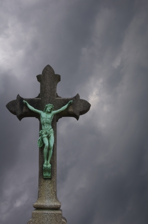 Copper statue of Jesus crucified on a cross photo