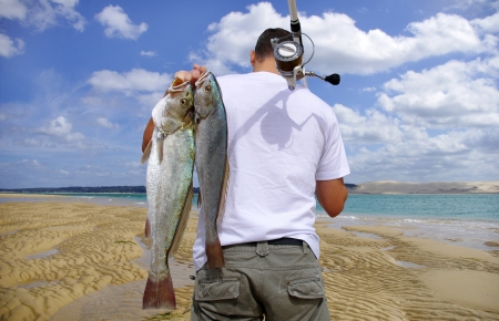 atrapar: Aventura pesca Foto de archivo