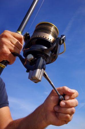 Close-up on fishing reel photo