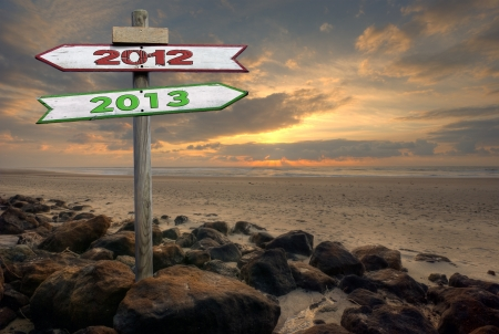 Double directional signs on a beach 2012 to 2013 Archivio Fotografico