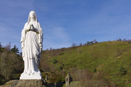 Statue of Virgin Mary isolated in the french country