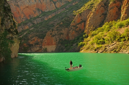 lure fisherman in a boat, alone in the wild  Santa Ana lake  Aragon, Spain Stock Photo - 20738069
