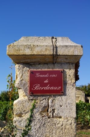 Street sign  grands vin de bordeaux  with wine in background  Bordeaux, Gironde, France