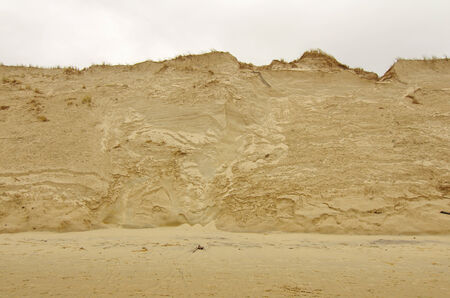 coastal erosion: sand dune erosion caused by major storm